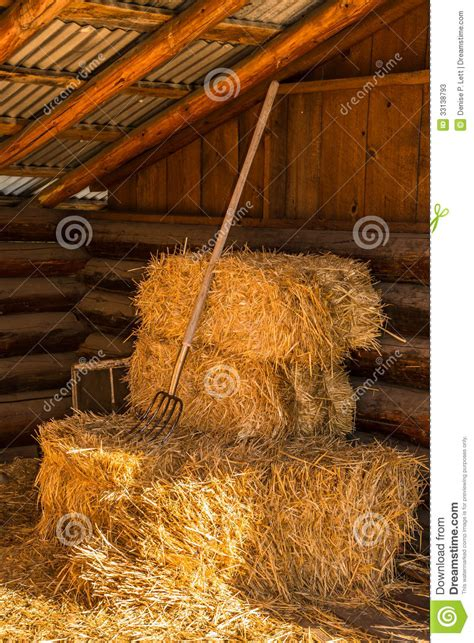 Loft Barn Plans Bales Of Straw Hay With Pitchfork In Barn Stock Photos