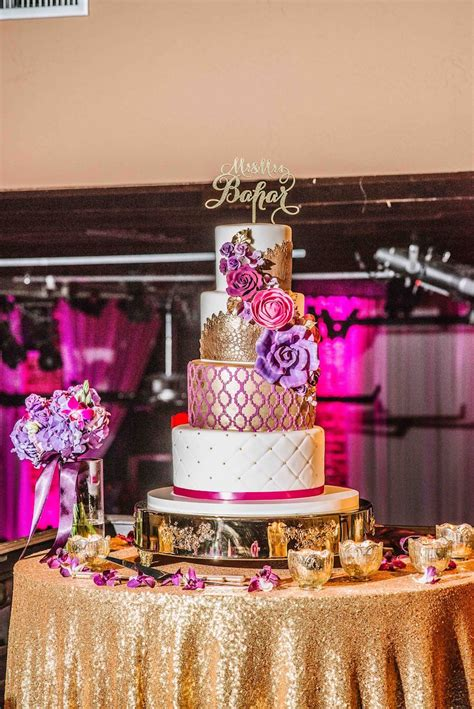 gold themes name four tier round gold pink and purple wedding cake and