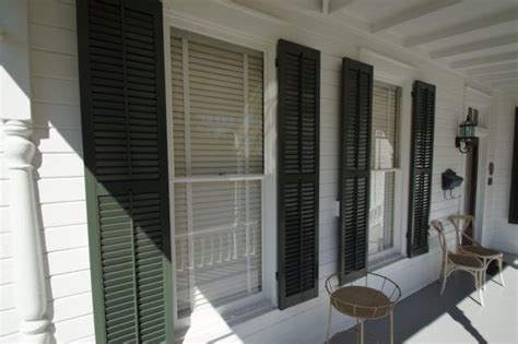 hanging decorative exterior shutters 17 best ideas about exterior wood shutters on