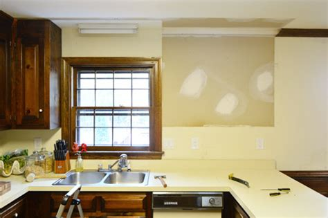 How To Take Down Kitchen Cabinets | removing some kitchen cabinets rehanging one young