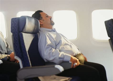 do larger airline passengers need to buy a second seat