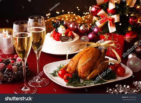christmas themed dinner table stock photo 215935333
