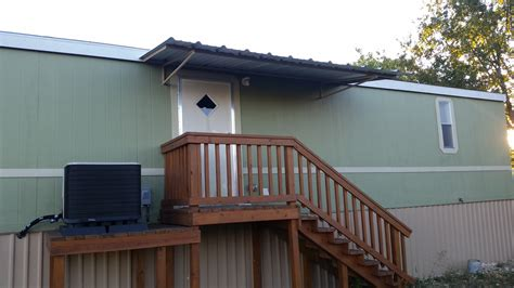 Awnings For Mobile Home Porches by Front And Back Awning With Carport Attached To Mobile Home