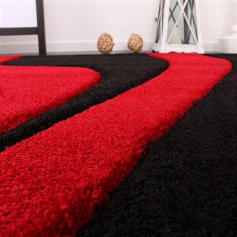teppich rot schwarz grau designer teppich mit konturenschnitt wellen muster rot