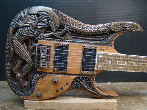 Handcrafted Guitar - h r giger carved wood electric guitar geekologie