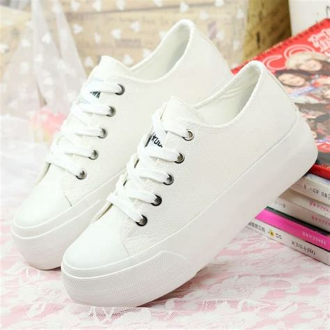 womens white sneaker looking in white shoes for storiestrending