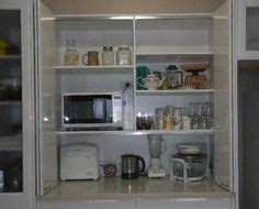appliance pantry bi fold doors white modern kitchen www 1000 images about kitchen ideas on pinterest appliance