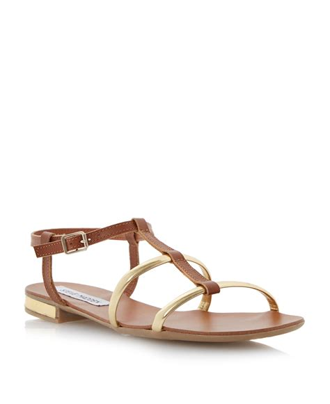 steve madden suave leather flat buckle sandals in brown lyst