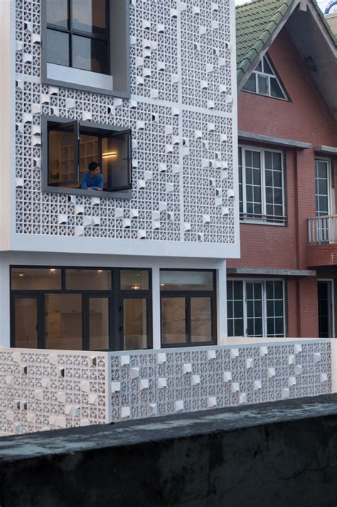 unique concrete blocks in cocoon home s facade in