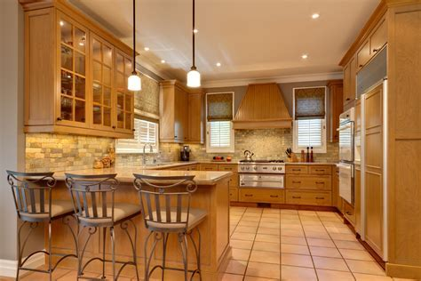 honey maple cabinets Kitchen Contemporary with bronze