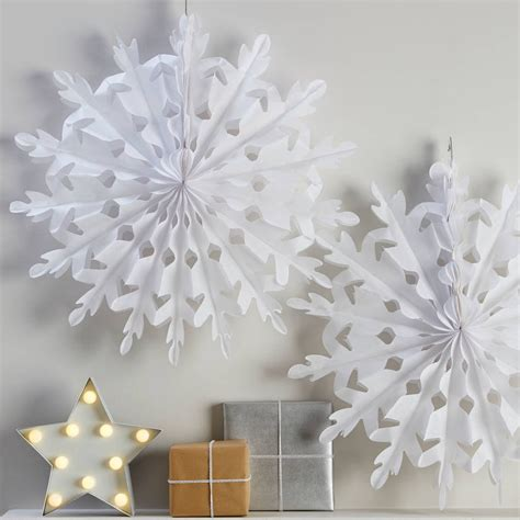 Snowflake Hanging Decoration two white hanging snowflake decorations by