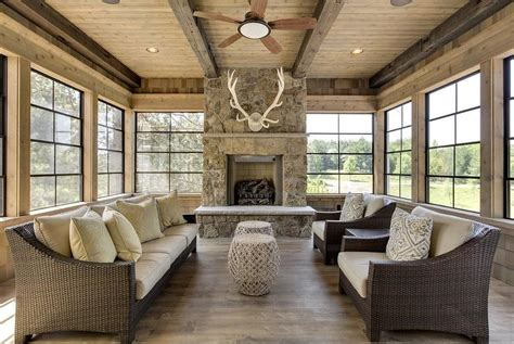fire place in sun room country cabin sunroom with antlers fireplace country deck patio