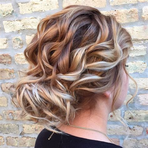 We're in love with this undone curly updo by stylist