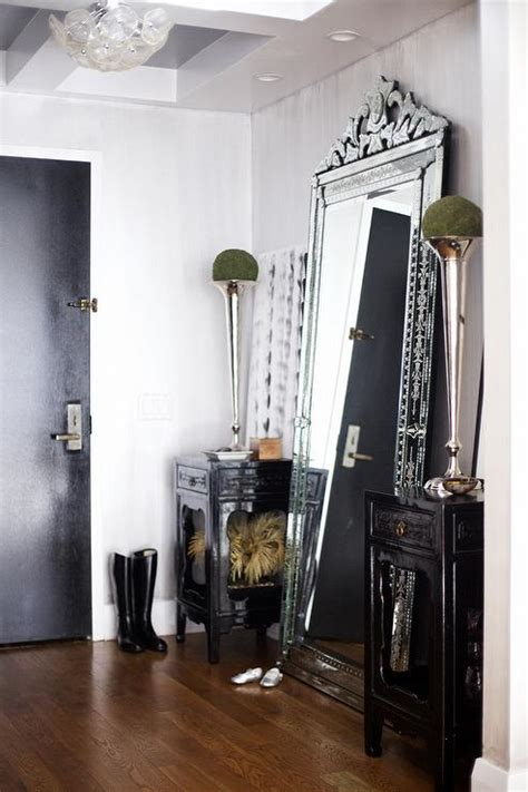 chair in front of leaning mirror design ideas