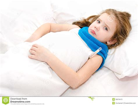 girl lying in bed sick little girl lying in the bed stock photo image