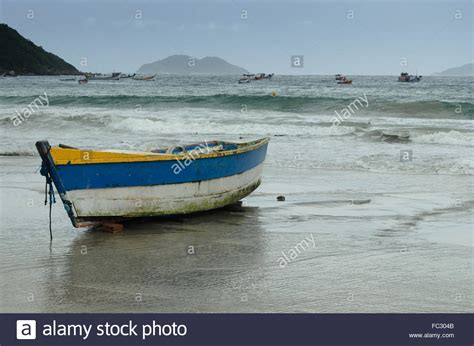 fishing boat on the beach old wooden fishing boat on the beach at sunset stock photo