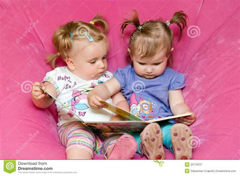 Baby Reading Pink two toddlers reading together royalty free stock photography image 20778707