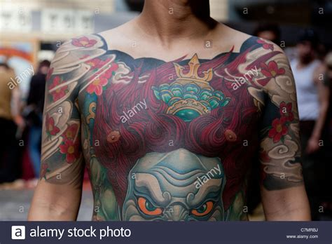 full body tattoo convention a member of the taiwanese east tattoo studio displays a