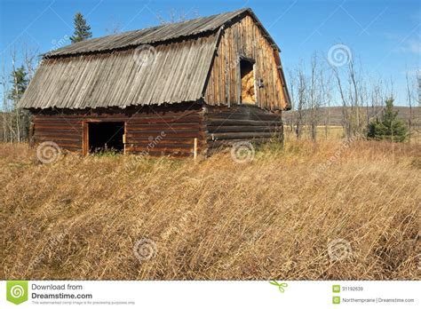 old log barn stock photos image 16113943 abandoned log barn in grassy field royalty free stock
