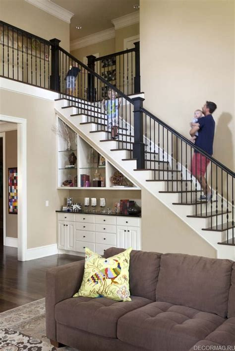 living room to basement stairs под лестницей home staircases basements and house