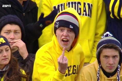 furious michigan fan flips off refs before espn cameras