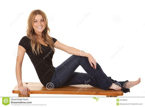 woman on bench woman on bench jeans royalty free stock images image 22428649