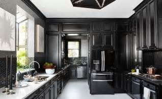 Integrated into the glossy black cabinets of this dream kitchen are
