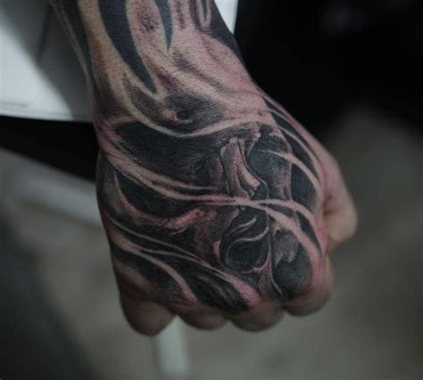 skull guys hand tattoo best tattoo design ideas