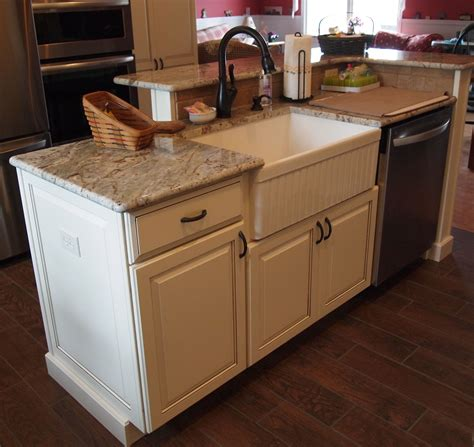 kitchen island with farm sink and dishwasher and elevated