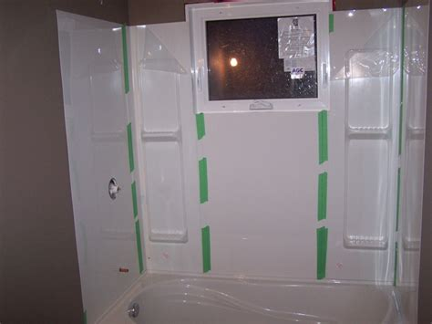 bathtub surround with window tub surround 5 pieces installed taped to hold it there
