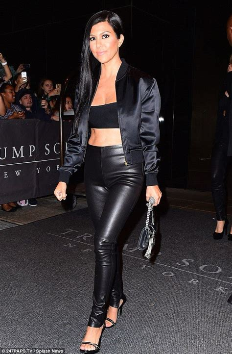 Jaket Ariel Ac kourtney shows firm abs in black bandeau and