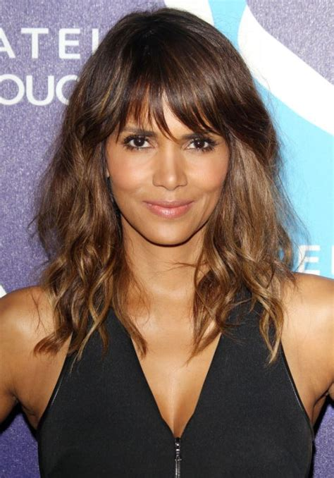 short hair long bangs tucked behind ear 24 trendy women haircuts with a fringe to try styleoholic