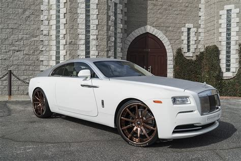 rose gold cars lapping in luxury wraith on s206