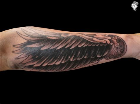 angel wing tattoo on forearm arm wing tattoo love