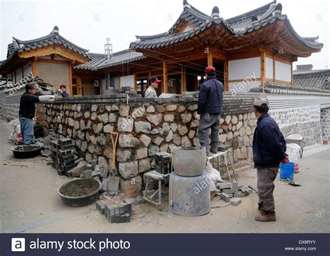 how to buy a house in korea workers work to build a house at a korean traditional hanok village stock photo