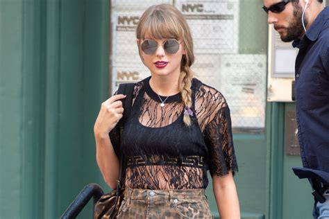 taylor swift cat heels taylor swift takes cats movie inspo with leopard skirt
