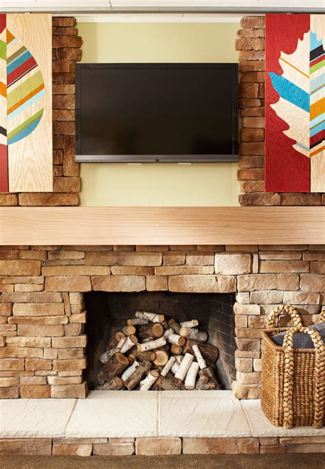 diy fireplace cover up artwork that slides to hide your tv