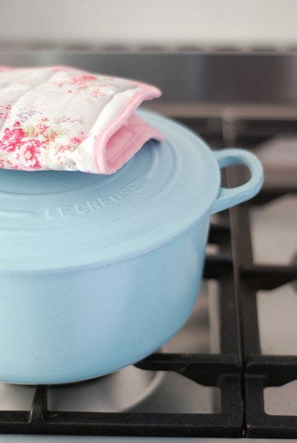 light blue le creuset im holding   mint green  cherry red  match  kitchen