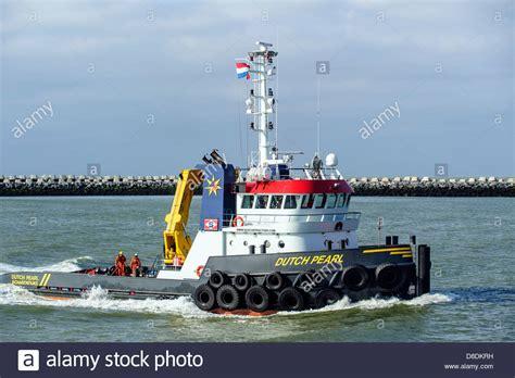 Tug Boat Shoppinf pusher tug boat pearl on the sea netherlands stock photo royalty free image