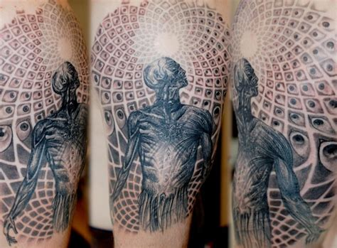 amazing man and the universe tattoo on arm by maris pavlo