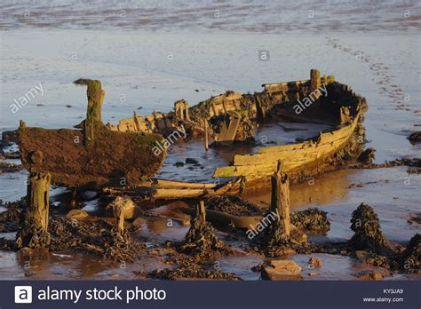 old dinghy boat old wooden dinghy rowing boat stock photos old wooden