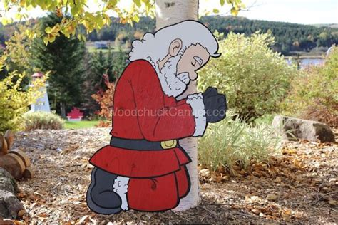 santa camo claus kneeling  prayer yard art woodworking