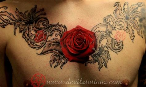 chest tattoo with roses off the map tattoo tattoos body part chest tattoos for