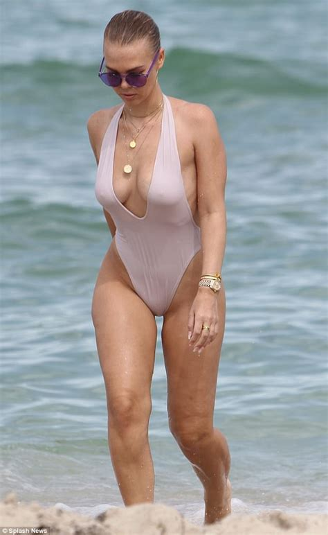 Bianca Elouise hits Miami Beach in plunging swimsuit   Daily Mail Online