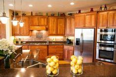 how to stagger existing cabinets honey oak cabinets with orange wall kitchen ideas