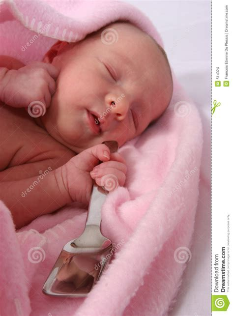 Baby Born Hers baby born with silver spoon in stock images