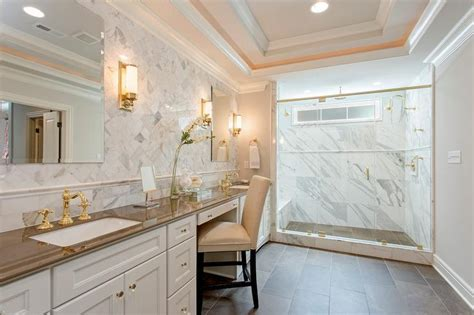 brown quartz countertops with white cabinets brown and white bathroom