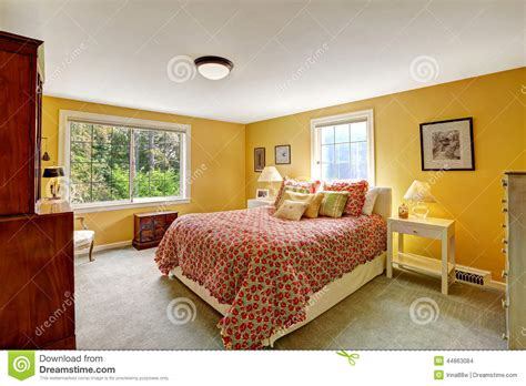 bright red bedroom cheerful bedroom interior in bright yellow color stock