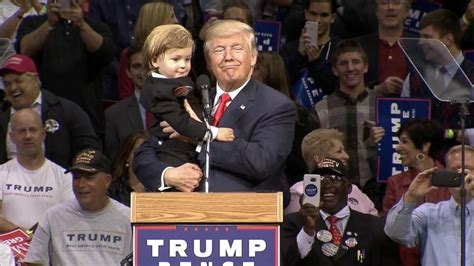 donald trump with kid child dressed as donald trump joins the candidate on stage
