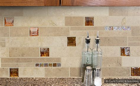 brown countertop with travertine glass mix backsplash